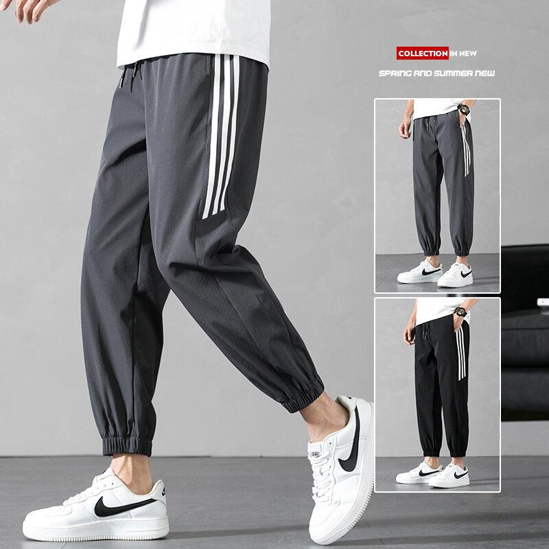 K006四面弹透气束脚薄款修身男士九分裤2020夏季速干冰丝运动休闲