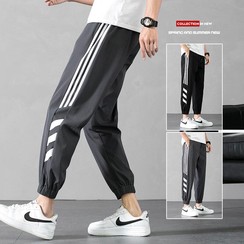 K004四面弹透气束脚薄款修身男士九分裤2020夏季速干冰丝运动休闲
